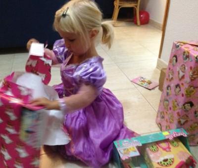 Isla opening her presents