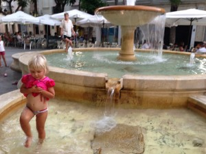 Isla having fun at a fountain.